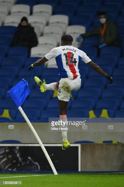 Jean-Philippe Mateta of Crystal Palace celebrates after scoring the opening goal during the Premier League match between Brighton & Hove Albion and...