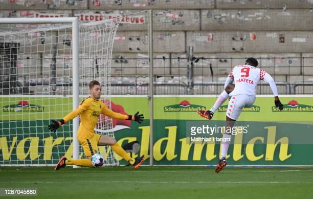 Jean-Philippe Mateta of FSV Mainz 05 scores their sides third goal during the Bundesliga match between Sport-Club Freiburg and 1. FSV Mainz 05 at...