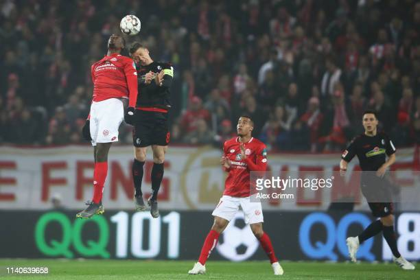 JeanPhilippe Mateta of FSV Mainz batt Mike Frantz of SC Freiburg during the Bundesliga match between 1 FSV Mainz 05 and SportClub Freiburg at Opel...