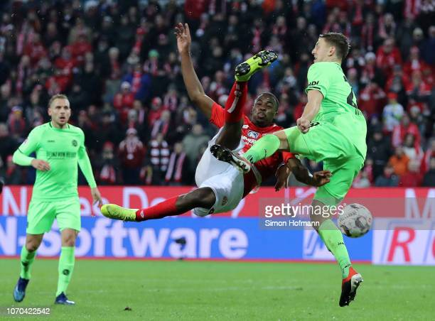 JeanPhilippe Mateta of FSV Mainz battles for the ball with Kevin Wimmer of Hannover 96 during the Bundesliga match between 1 FSV Mainz 05 and...