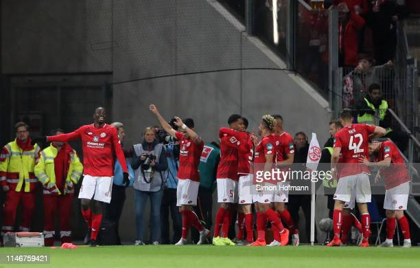 JeanPhilippe Mateta of FSV Mainz celebrates after scoring his sides third goal during the Bundesliga match between 1 FSV Mainz 05 and RB Leipzig at...