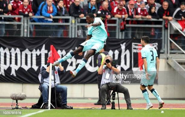 JeanPhilippe Mateta of FSV Mainz celebrates scoring his team's first goal during the Bundesliga match between 1 FC Nuernberg and 1 FSV Mainz 05 at...