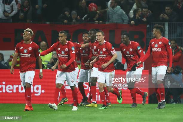 Jean-Philippe Mateta of FSV Mainz celebrates scoring his teams third goal of the game with team mates during the Bundesliga match between 1. FSV...
