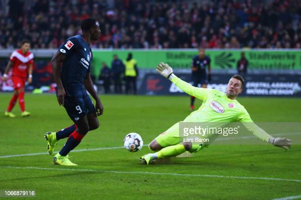 JeanPhilippe Mateta of FSV Mainz shoots on goal as Goalkeeper Michael Rensing of Fortuna Dusseldorf makes a save during the Bundesliga match between...