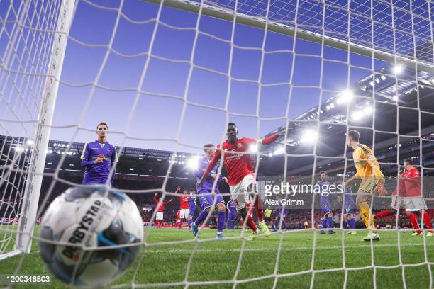 JeanPhilippe Mateta of Mainz scores his team's first goal past goalkeeper Alexander Schwolow of Freiburg during the Bundesliga match between 1 FSV...