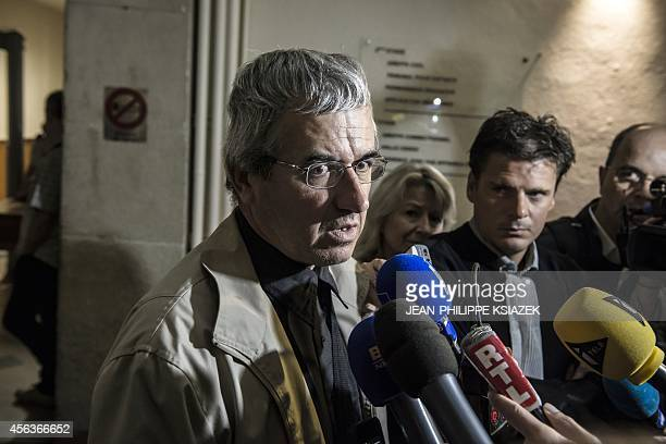 JeanPhilippe Meyer father of MarieJeanne speaks to journalists next to his lawyer David Metaxas on the opening day of the trial of Anthony Draoui the...