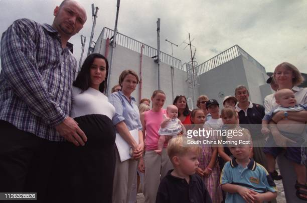 Jean-Pierre Bagnato and his pregnant wife Dawn, join other tenants on the rooftop of the Pokfulam government residential building to discuss the...