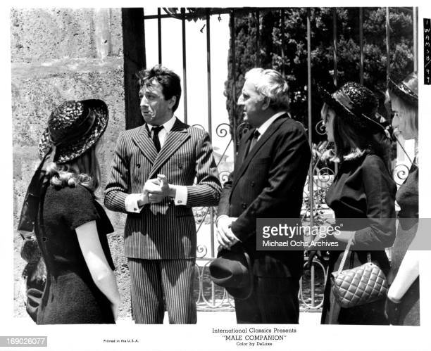 JeanPierre Cassel and Adolfo Celi dressed in a suit attending a formal function in a scene from the film 'Male Companion' 1964