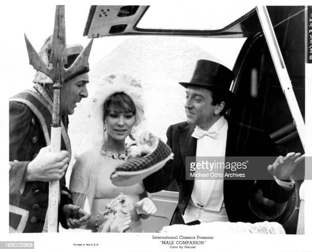 Jean-Pierre Cassel and Irina Demick in wedding attire with in a scene from the film 'Male Companion', 1964.