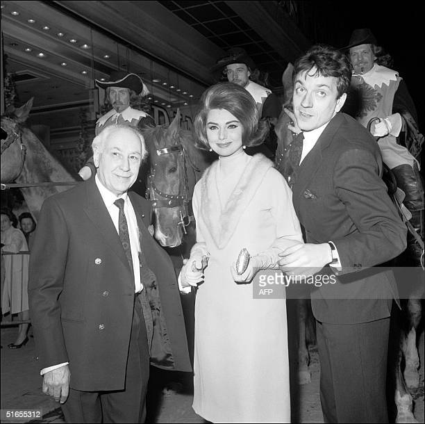 JeanPierre Cassel and Sylva Koscina actors of Cyrano et D'Artagnan directed by Abel Gance face the camera at the World PremiFre in a cinema of the...