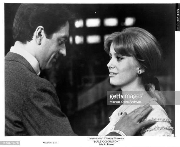 Jean-Pierre Cassel with his hand on Irina Demick as they look into one an others eyes in a scene from the film 'Male Companion', 1964.