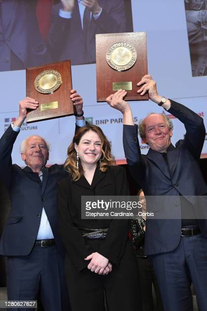 """Jean-Pierre Dardenne, Emilie Dequenne and Luc Dardenne on stage holding their award """"Prix Lumiere"""" during the tribute to the brothers Jean-Pierre..."""
