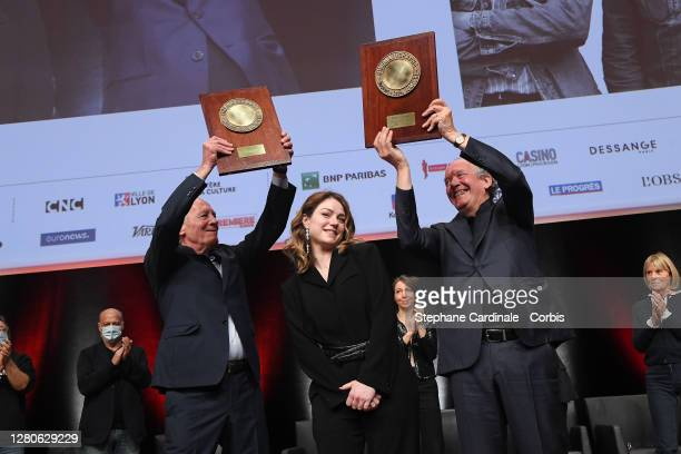 """Jean-Pierre Dardenne , Luc Dardenne on stage holding their award """"Prix Lumiere"""" and Emilie Dequenne during the tribute to the brothers Jean-Pierre..."""