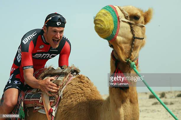 JeanPierre Drucker of Luxembourg and the BMC Racing Team sits on a camel at the start of stage four of the 2016 Tour of Qatar a 189km road stage from...