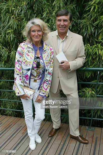 JeanPierre Foucault and his wife arrive in the 'Village' the VIP area of the French Open at Roland Garros arena in Paris France on June 7 2007