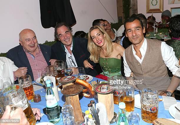 JeanPierre Goddet director Oliver Stone his nice Caroline Goddet and her husband Erol Sander during the Oktoberfest at Kaeferschaenke at...