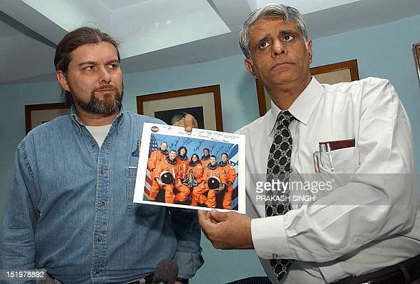 JeanPierre Harrison the husband of late astronaut Kalpana Chawla poses with principle of Punjab Engineering College Dr Baljeet S Kapoor after he...