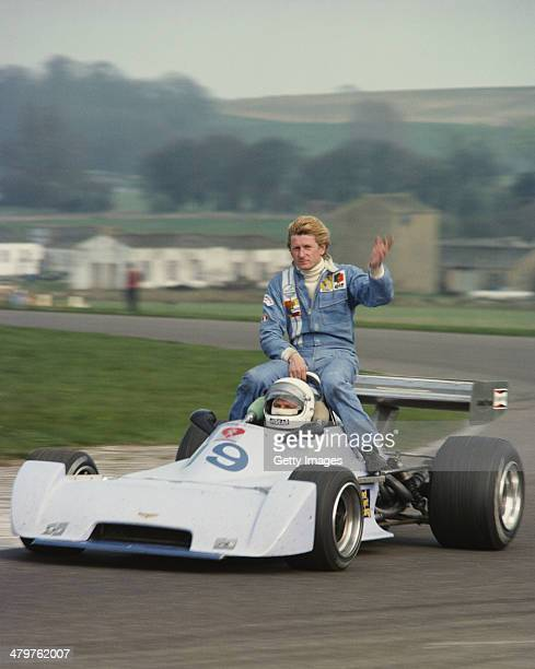 Jean-Pierre Jabouille accepts a lift aboard the Fred Opert Racing Chevron B35 Hart 420R of Jose Dolhem during the V Jochen Rindt Memorial European F2...