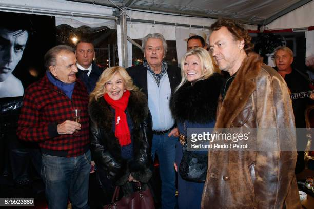 JeanPierre Kalfon Nicoletta Alain Delon guest and JeanChristophe Molinier attend La Grande Roue de Paris Opening Ceremony at Place de la Condorde on...