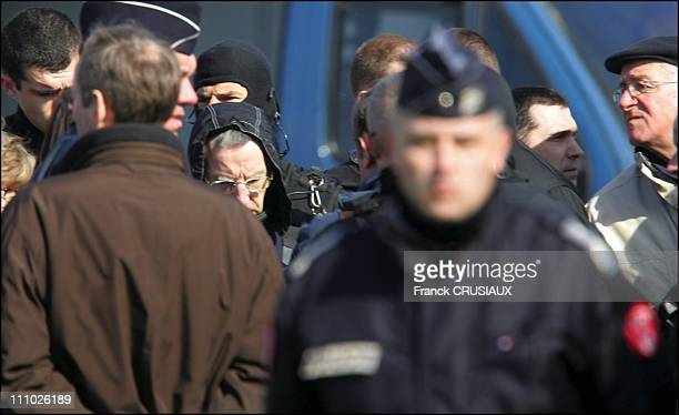 JeanPierre Leroy father of Fabienne Leroy looks at Michel Fourniret during the reconstruction of the abduction and murder of the former's daughter in...