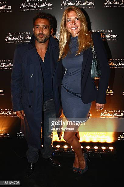 JeanPierre Martins and Alexandra Genoves attend the Nicolas Feuillatte 35th anniversary at Maison de l'Architecture on June 9 2011 in Paris France