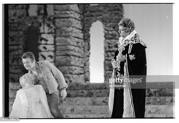 Jean-Pierre Ponnelle, the director demonstrates to Placido Domingo as Otello how he wants Katia Ricciarelli as Desdemona thrown to the ground in a...