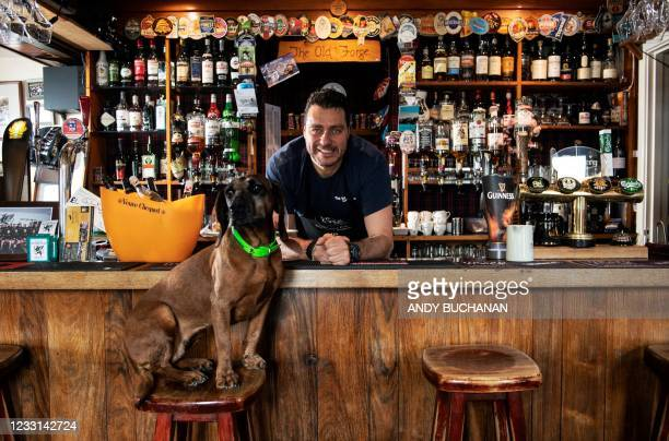 Jean-Pierre Robinet, owner of The Old Forge, poses for a photo behind the bar in his pub in Inverie on the Knoydart peninsular in the Scottish...