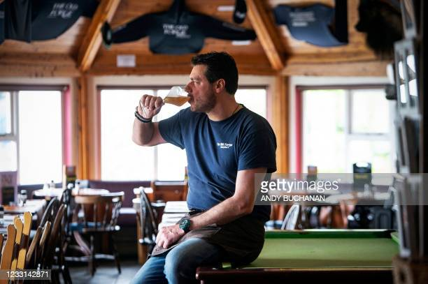 Jean-Pierre Robinet, owner of The Old Forge, poses for a photograph inside his pub in Inverie on the Knoydart peninsular in the Scottish Highlands on...