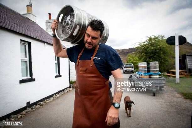 Jean-Pierre Robinet, owner of The Old Forge, poses for a photograph outside his pub in Inverie on the Knoydart peninsular in the Scottish Highlands...