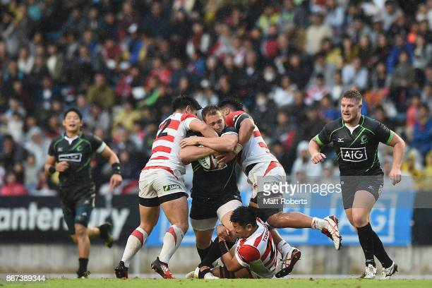 JeanPierre Smith of World XV is tackled during the international match between Japan XV and World XV at Level Five Stadium on October 28 2017 in...