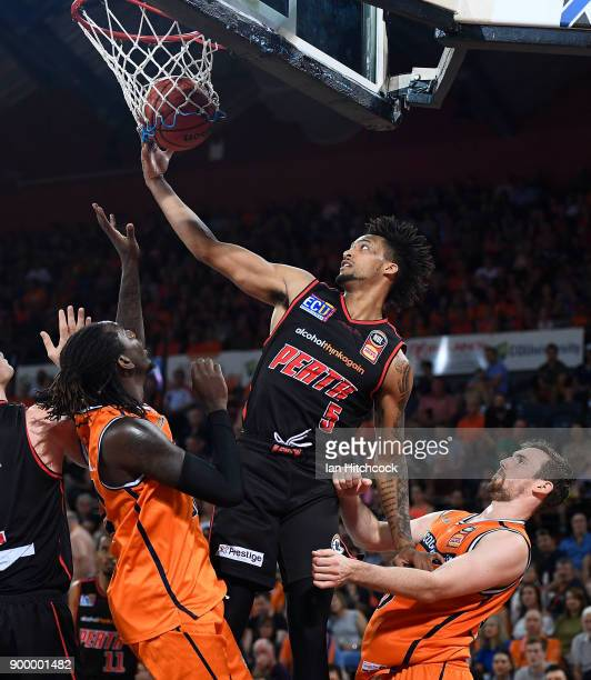 JeanPierre Tokoto of the Wildcats attempts to regather the ball during the round 12 NBL match between the Cairns Taipans and the Perth Wildcats at...