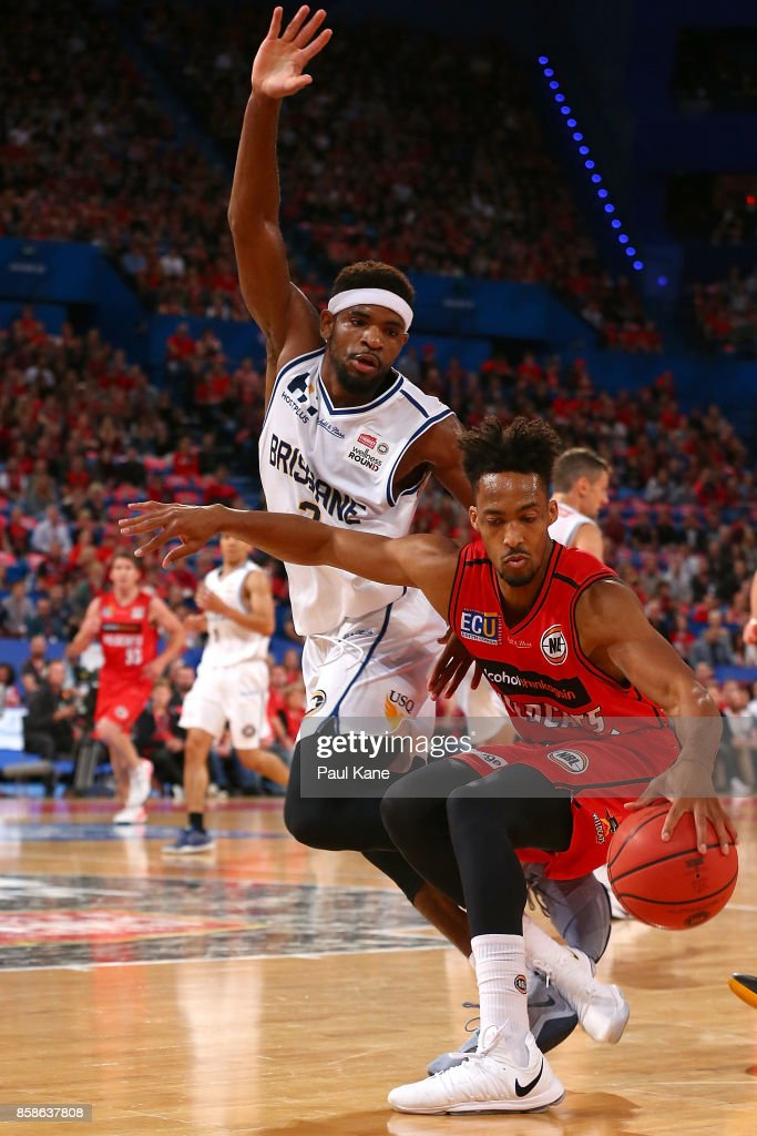 Jean-Pierre Tokoto of the Wildcats controls the ball against Perrin Buford of the Bullets during the round one NBL match between the Perth Wildcats and the Brisbane Bullets at Perth Arena on October 7, 2017 in Perth, Australia.