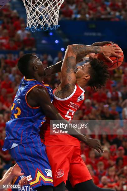 JeanPierre Tokoto of the Wildcats goes to the basket against Majok Deng of the 36ers during the round 17 NBL match between the Perth Wildcats and the...
