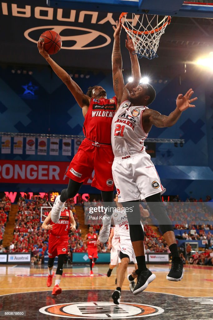 Jean-Pierre Tokoto of the Wildcats lays up against Delvon Johnson of the Hawksduring the round two NBL match between the Perth Wildcats and the Illawarra Hawks at Perth Arena on October 13, 2017 in Perth, Australia.