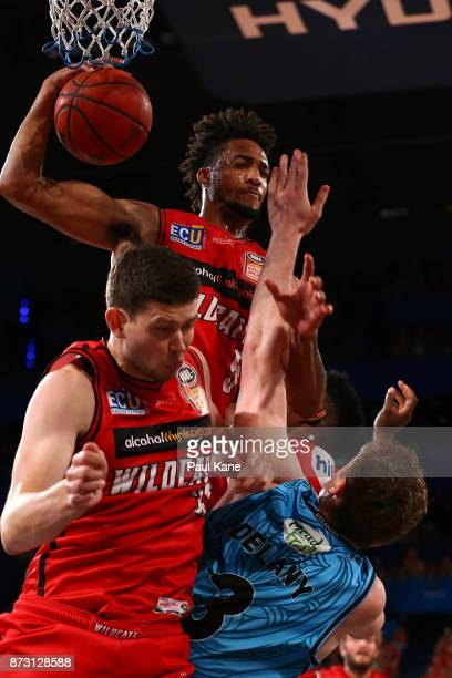 Jean-Pierre Tokoto of the Wildcats pulls down a rebound during the round six NBL match between the Perth Wildcats and the New Zealand Breakers at...