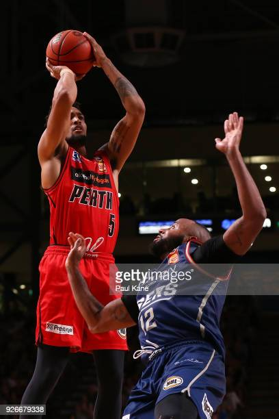 JeanPierre Tokoto of the Wildcats shoots the ball against Shannon Shorter of the 36ers during game one of the Semi Final series between the Adelaide...