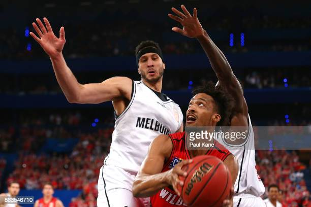 JeanPierre Tokoto of the Wildcats works to the basket against Josh Boone and Casey Prather of United during the round three NBL match between the...