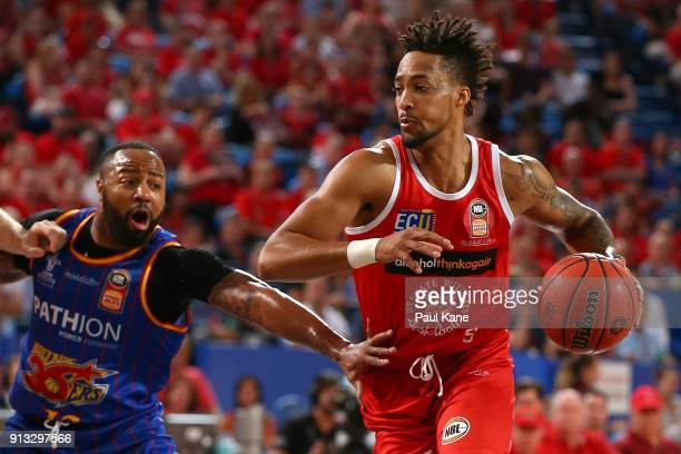 JeanPierre Tokoto of the Wildcats works to the basket against Shannon Shorter of the 36ers during the round 17 NBL match between the Perth Wildcats...