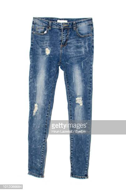 jeans against white background - ripped jeans stock photos and pictures