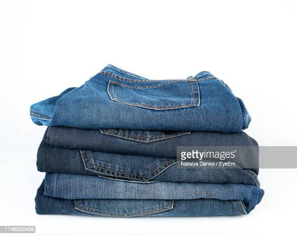 jeans against white background - jeans stock pictures, royalty-free photos & images