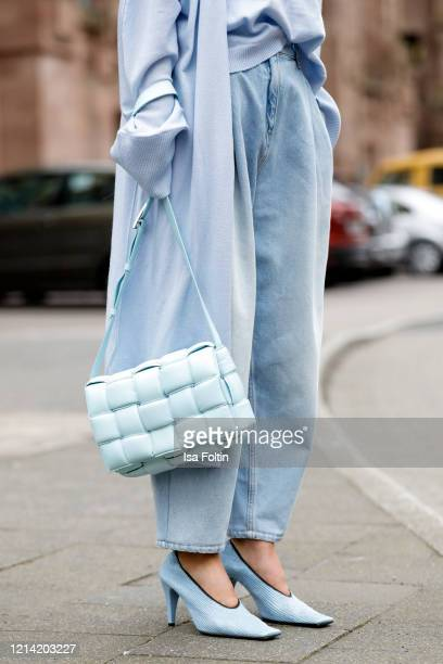 Jeans by Magda Butrym, a pastel blue cardigan by t7berlin, a topaz colored padded cassette bag and topaz colored crunch sharpei pumps by Bottega...