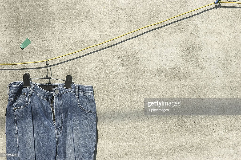Jeans drying on clothesline : Stock Photo