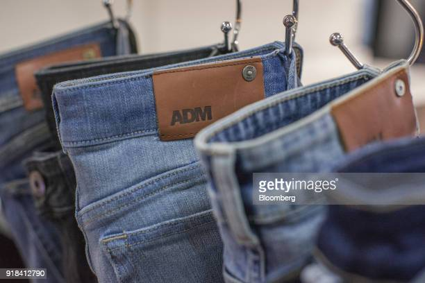 Jeans hang from pegs at the Artistic Denim Mills Ltd factory in Karachi Pakistan on Tuesday Feb 6 2018 Pakistans manufacturers have longsuffered from...