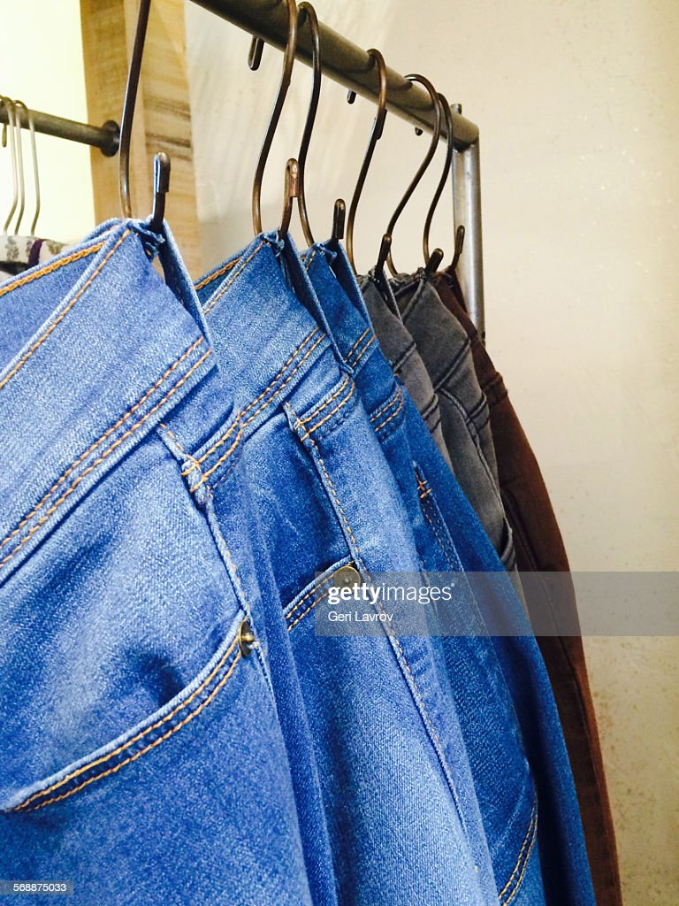 Jeans hanging on a hangar : Stock Photo
