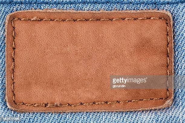 jeans leather patch - textile patch stock pictures, royalty-free photos & images