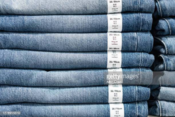 jeans stacked neatly - order stock pictures, royalty-free photos & images