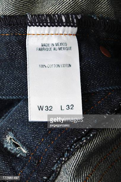 jeans tag - garment stock pictures, royalty-free photos & images