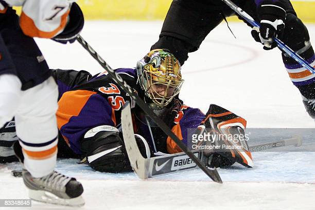 JeanSebastien Aubin of the Philadelphia Phantoms attempts to make a save during the first period against the Bridgeport Sound Tigers on October 19...