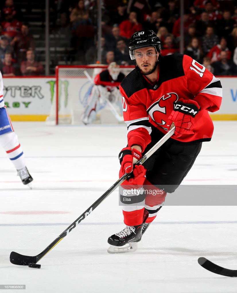 timeless design 2be34 b1c56 Jean-Sebastien Dea of the New Jersey Devils looks to pass in ...