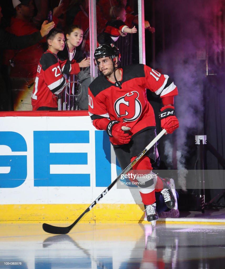 info for 4fded 11f96 Jean-Sebastien Dea of the New Jersey Devils skates against ...